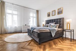 Postel nebo postele na pokoji v ubytování City Square Apartments