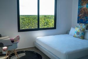 Un ou plusieurs lits dans un hébergement de l'établissement Jungle view Luxury Condo