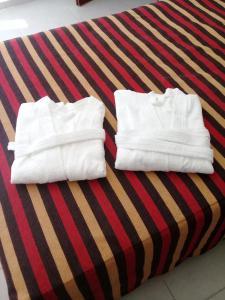 Una cama o camas en una habitación de Departamento Centrico Nuevo