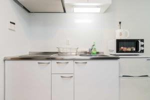 A kitchen or kitchenette at Ostay Tanimachi Hotel Apartment