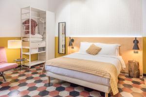 Letto o letti in una camera di monocase milano