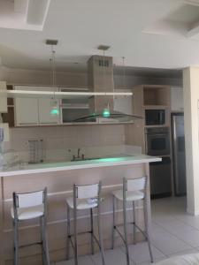 Una cocina o zona de cocina en Cobertura em Canasvieiras