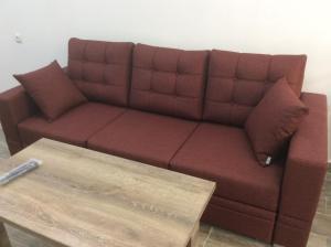 A seating area at Apartment on Saryan 24
