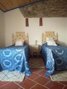 Uma cama ou camas num quarto em Casa do Montinho
