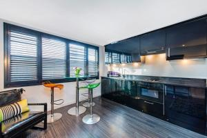 Eldhús eða eldhúskrókur á Chelsea Luxury Flat