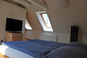 A bed or beds in a room at Appartements Altstadt