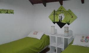 Una cama o camas en una habitación de Las Frutillas