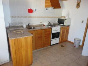 Una cocina o kitchenette en Sarmiento