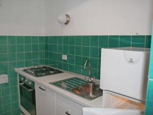 Kjøkken eller kjøkkenkrok på Locazione turistica Bellenda
