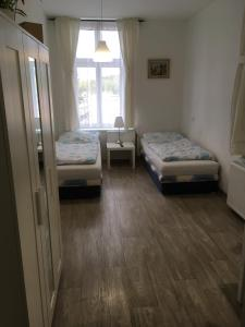 A bed or beds in a room at TopApartmany Lesni