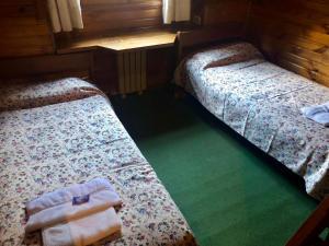 Una cama o camas en una habitación de El Maiten 5