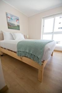 A bed or beds in a room at Urbano Apartments Miraflores Pardo