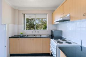 A kitchen or kitchenette at Waldorf North Parramatta Residential Apartments