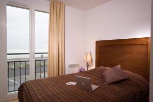 Un ou plusieurs lits dans un hébergement de l'établissement Madame Vacances Les Terrasses De La Plage