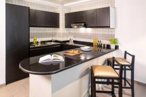 A kitchen or kitchenette at Citadines Metro Central Apartments
