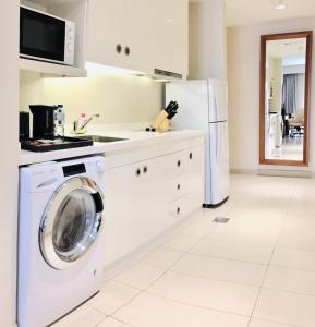 A kitchen or kitchenette at Somerset Panorama Muscat