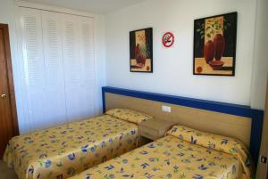Cama o camas de una habitación en Apartamentos Paraiso 10