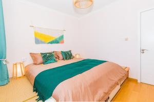 A bed or beds in a room at Qingdao Shibei·Qingdao Carrefour· Locals Apartment 00165960