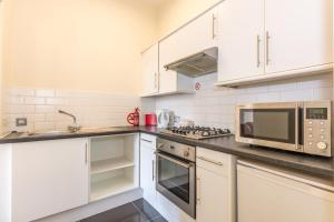 A kitchen or kitchenette at Menzies Apartments