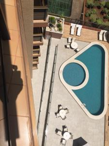 A view of the pool at Evandro Apart Hotel or nearby