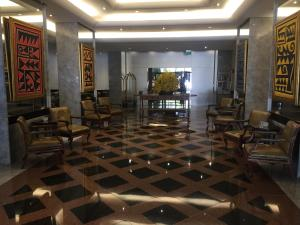The lobby or reception area at Evandro Apart Hotel