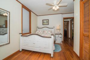 A bed or beds in a room at Adorable Bungalow steps to Downtown and the Beach!!