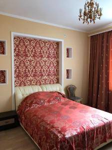 Кровать или кровати в номере Уютный центр