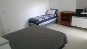 Cama ou camas em um quarto em Apartamentos Mirante de Escarpas