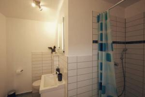A bathroom at Apartment in Unterbach