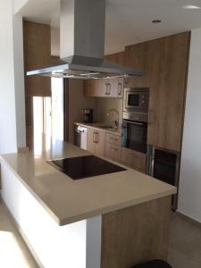 A kitchen or kitchenette at Casa Villa Martin Gardens