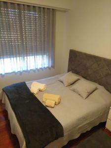 A bed or beds in a room at Sun and Sea Oporto View II