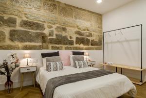 Cama o camas de una habitación en Verdura Suites ArchSense Apartments