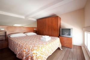 Un ou plusieurs lits dans un hébergement de l'établissement AB Paseo de Gracia Apartments