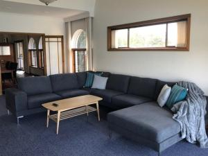 A seating area at My Hobart Stay - Holiday Rentals