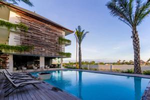 The swimming pool at or close to The Double View Mansions Bali