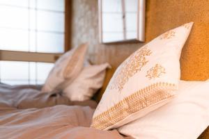 Krevet ili kreveti u jedinici u okviru objekta Kyo-Koyado Komorebi