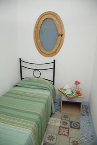 A bed or beds in a room at Baglio Locoforte