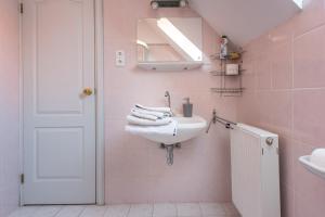 A bathroom at Flora Villa