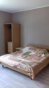 A bed or beds in a room at Дом
