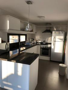 A kitchen or kitchenette at Penthouse 356