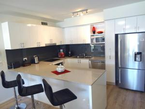 A kitchen or kitchenette at Waterfront Resort Villa with Buggy