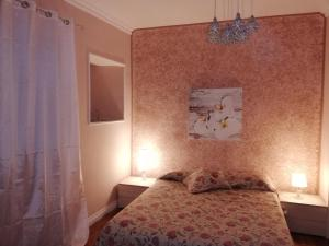 A bed or beds in a room at Chiaia 100