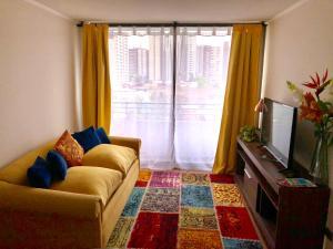 Zona de estar de Andes Apart Homes: Carmenere