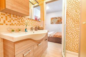 Uma casa de banho em Appartamento con Spiaggia Privata Wi-fi Parking