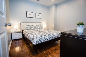 A bed or beds in a room at Lawrenceville Suites