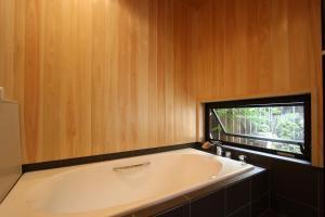 A bathroom at Hatoba an Machiya House