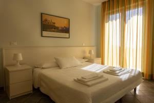 Giường trong phòng chung tại Olivium