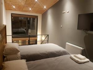 Posteľ alebo postele v izbe v ubytovaní EcoLofts Croacia 1028