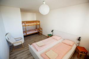 A bunk bed or bunk beds in a room at Apartments Pod Kotlom