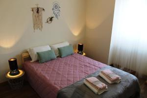 A bed or beds in a room at Tile House